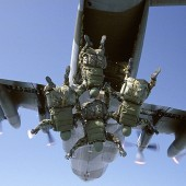 Linked Exit - A patrol diving into the void on a High Altitude Low Opening (HALO) jump from above 25000 feet. *