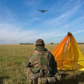 Marker – Establishing a drop zone (DZ) as C130 Hercules deliver their cargo of paratroopers. *