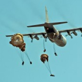 Up 800 feet 90 men Jumping – A C130 Hercules aircraft dropping paratroopers into action.